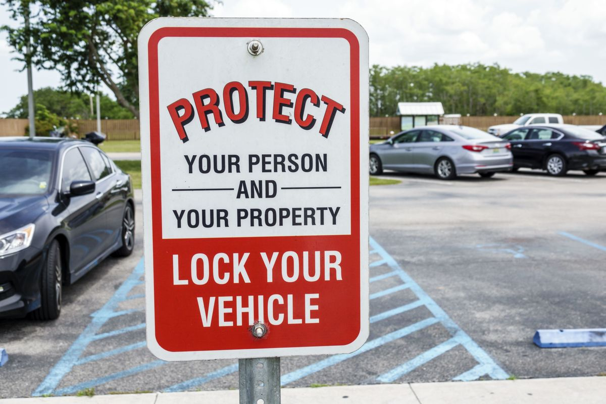 a protect your car sign.