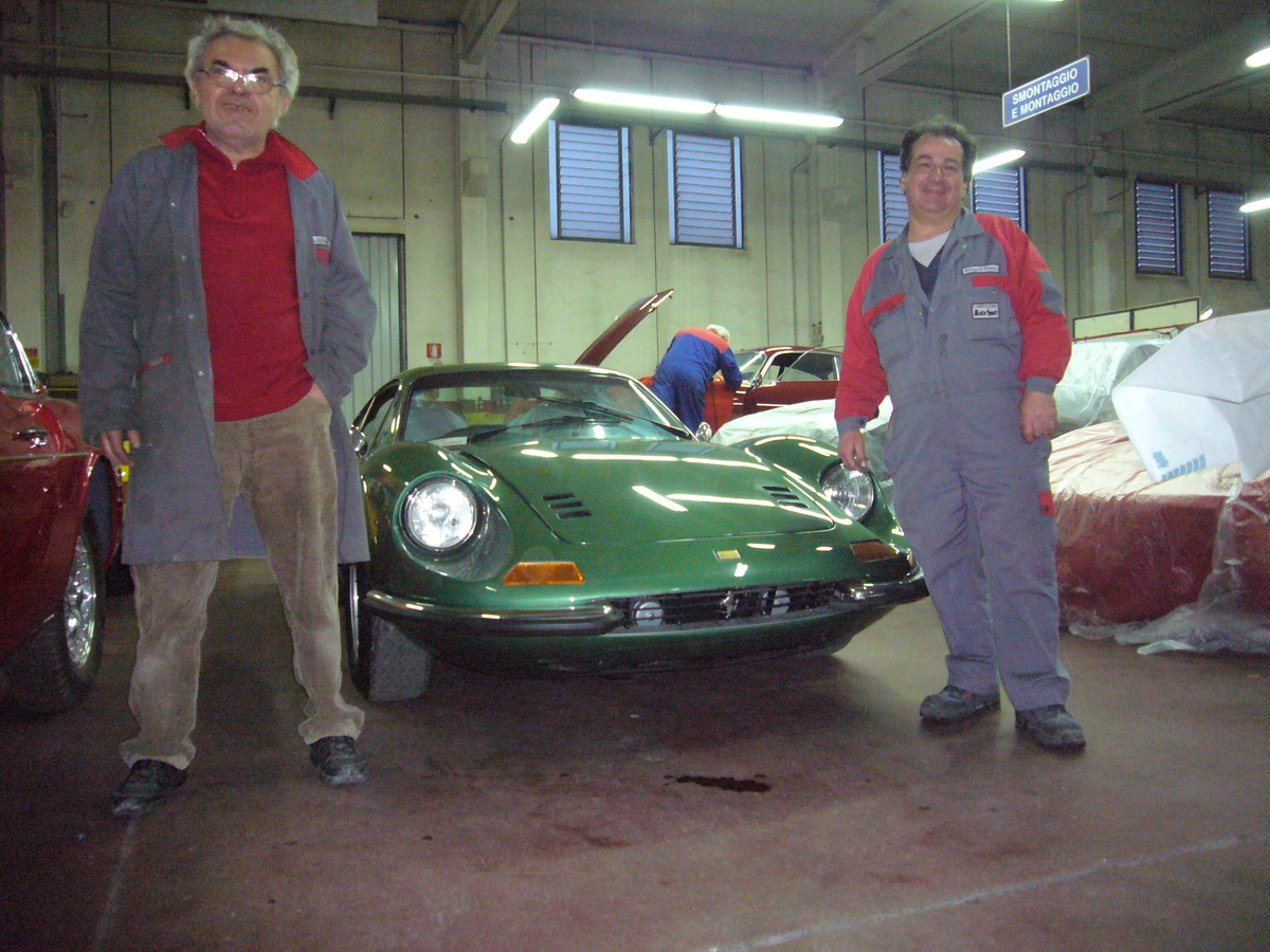 two guys next to 264 dino ferrari