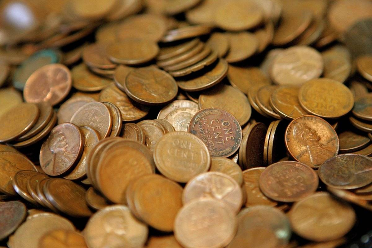 A pile of copper pennies is seen.