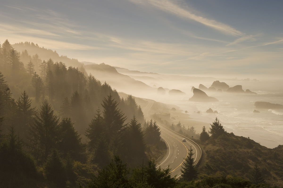 Beach, sea stacks and Highway 101 on a foggy morning; Cape Sebastian State Scenic Corridor, southern Oregon coast.