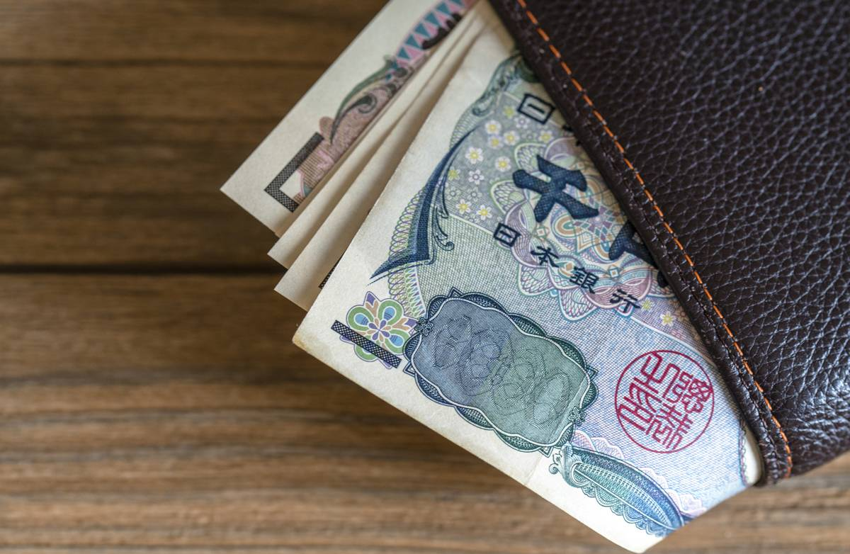 Yen banknotes in a wallet. In the early march, Japan's core...