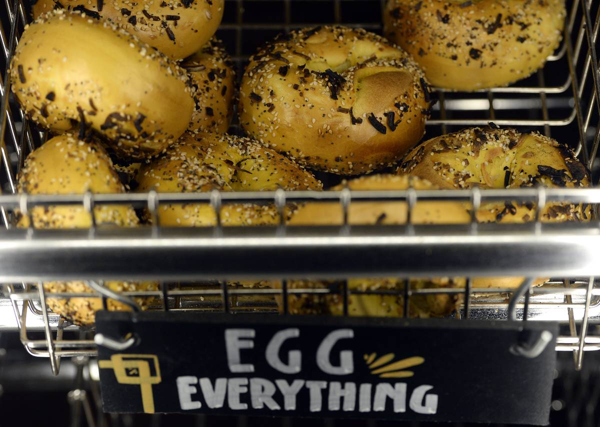 Egg everything bagels are for sale at a bakery.