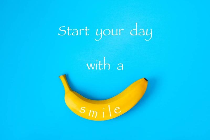 A banana is on a blue background with text that says,