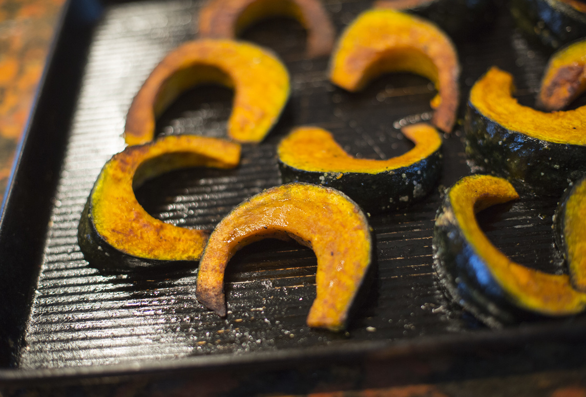 Slices of butternut squash are being roasted.