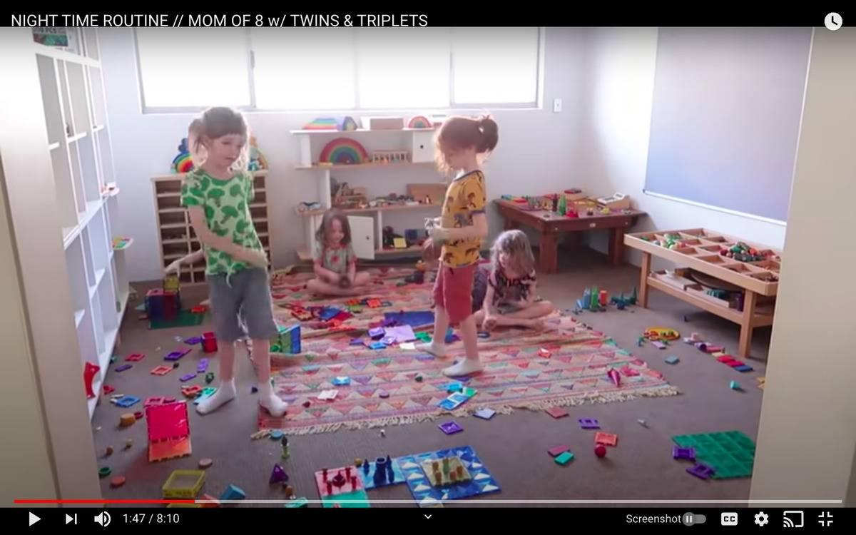 kids tidying up playroom