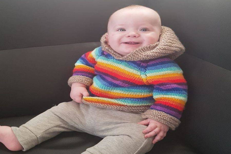brett baby smiling in a sweater