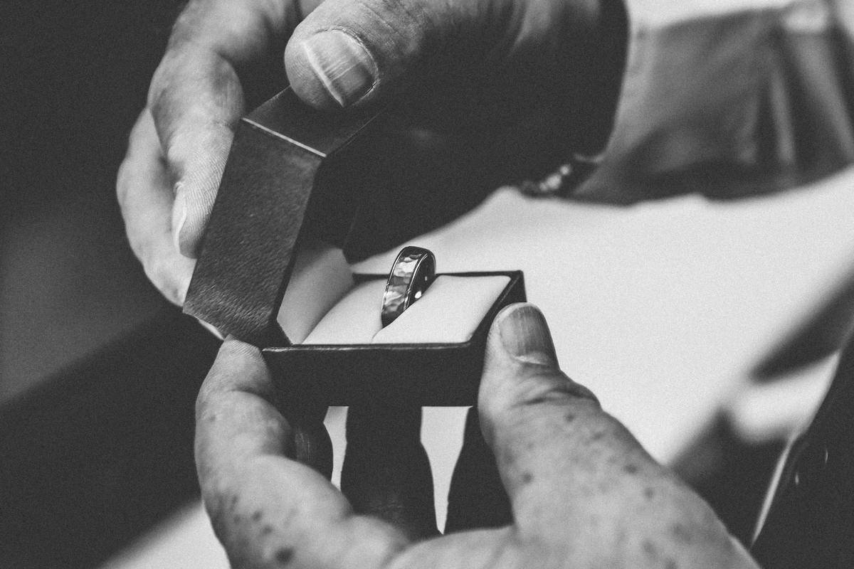 man holding open ring box