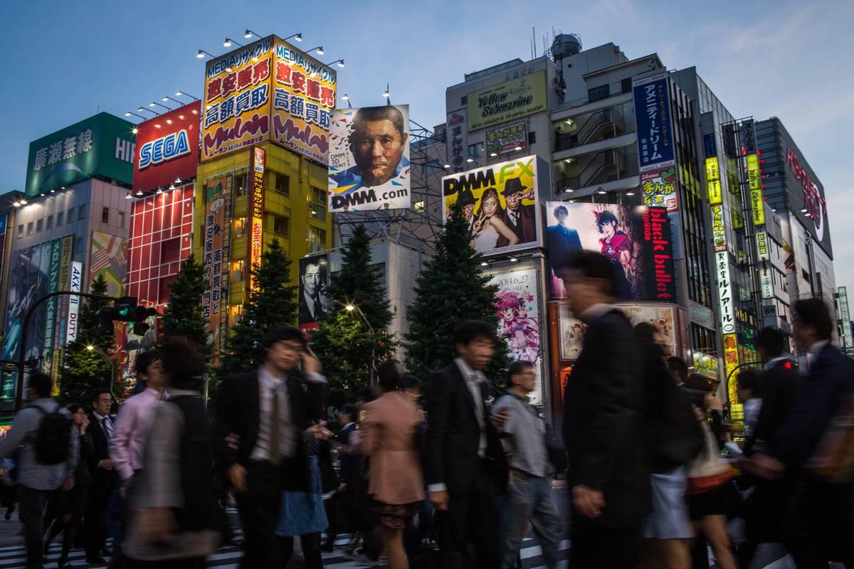 People walk on the street in Akihabara, Electric Town in Tokyo, Japan