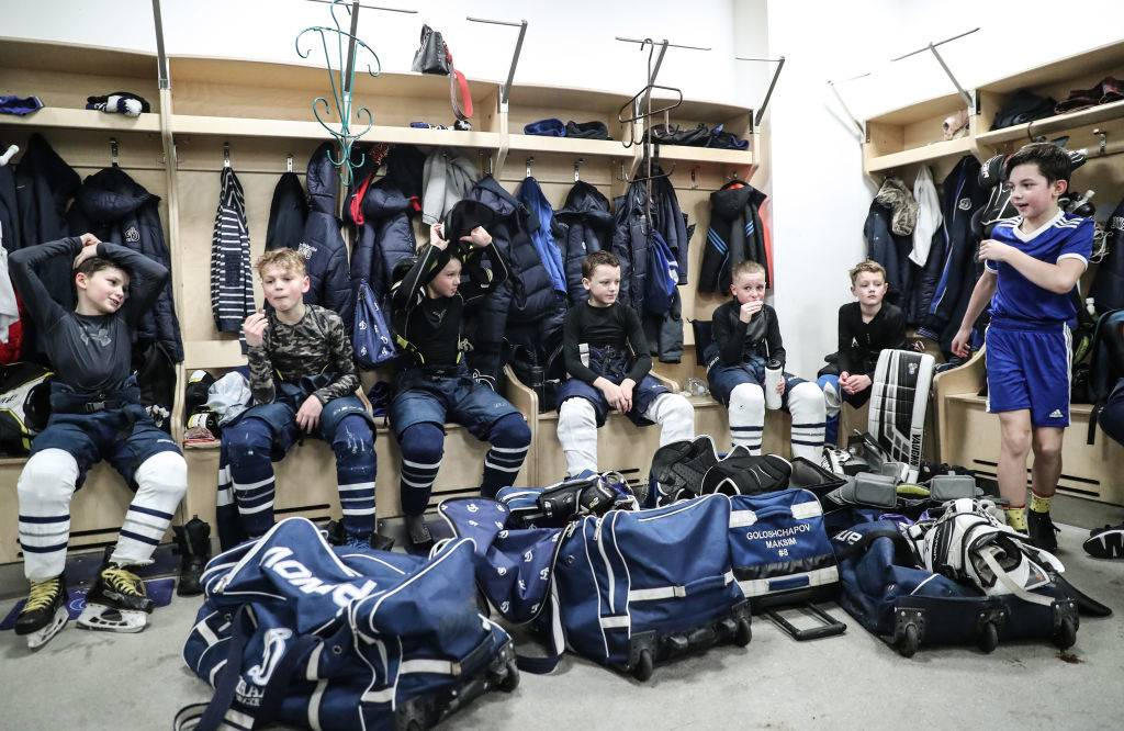 Children in a changing room after an ice hockey practice