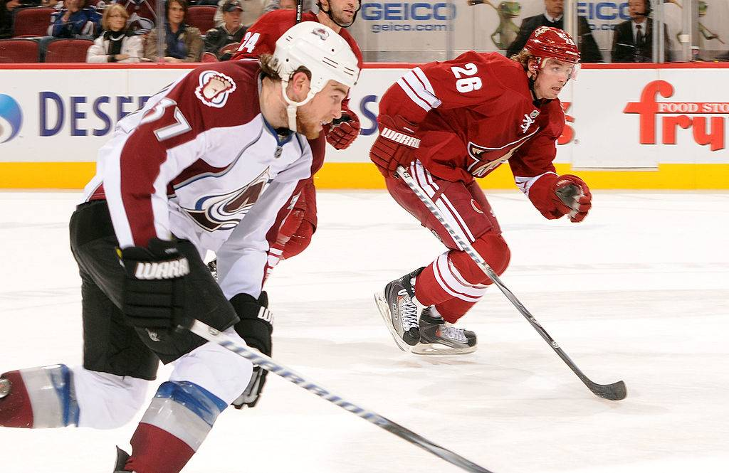 Cal O'Reilly #26 of the Phoenix Coyotes and brother Ryan O'Reilly #37 of the Colorado Avalanche race up ice