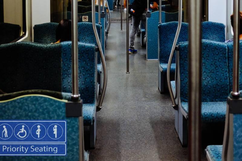 Priority seating image on public transit seat.