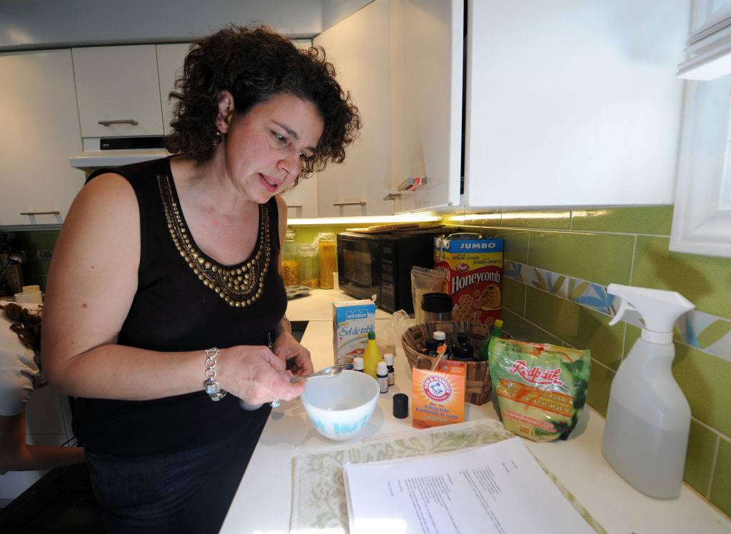 a woman using a recipe with baking soda