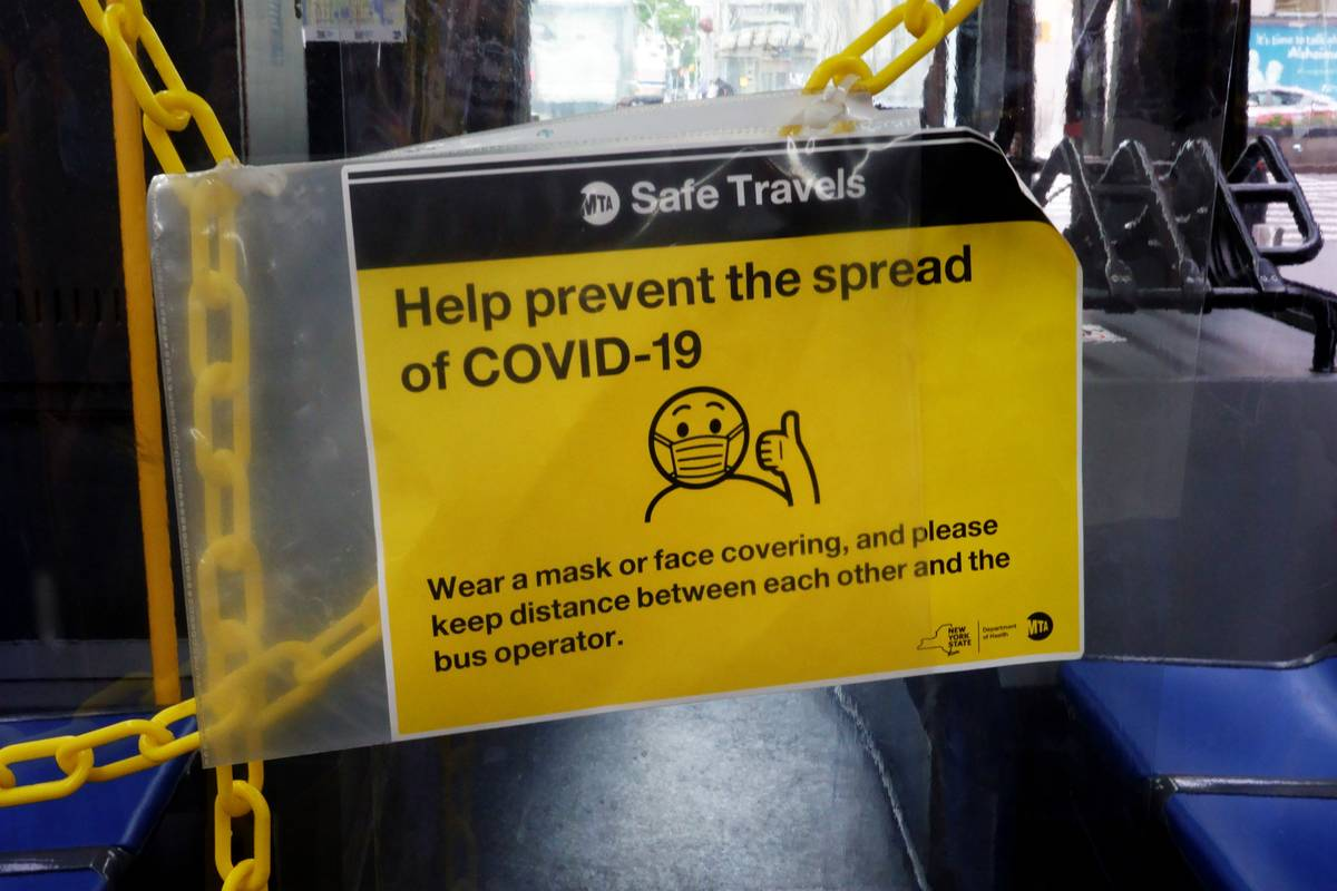 Bus driver area with plastic protective shield during Coronavirus Pandemic, New York City