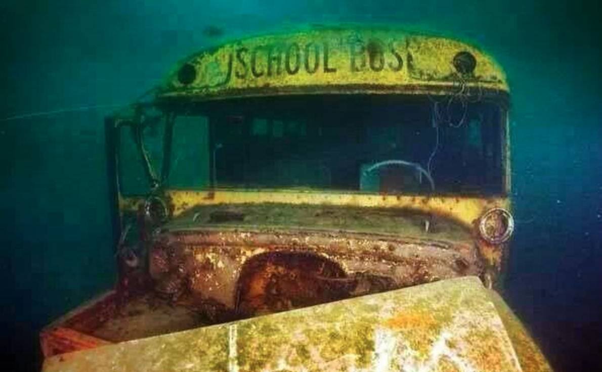 The front of an underwater school bus is pictured.